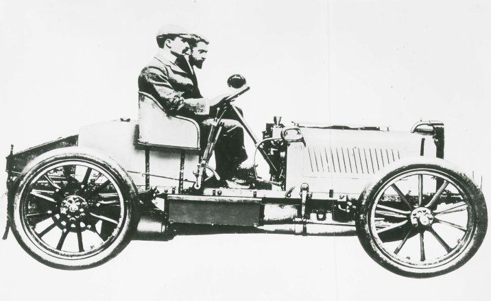Montague Stanley Napier [bearded] beside Selwyn Francis Edge in the four cylinder Napier racing car. This is the car in which Edge won the first international motorsports award, the 1902 Gordon Bennett Trophy