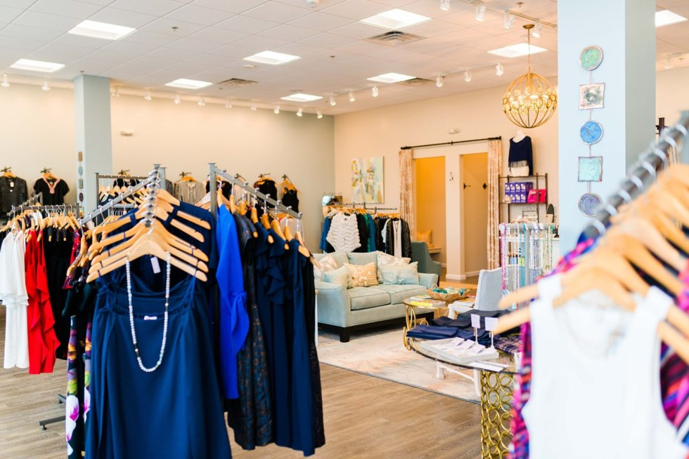 The Ultimate Girls' Day Out in Raleigh - I'm Fixin' To - @imfixintoblog | Girls Day Out In Raleigh by popular NC lifestyle blog, I'm Fixin' To: image of clothes hanging on clothing racks in a boutique.