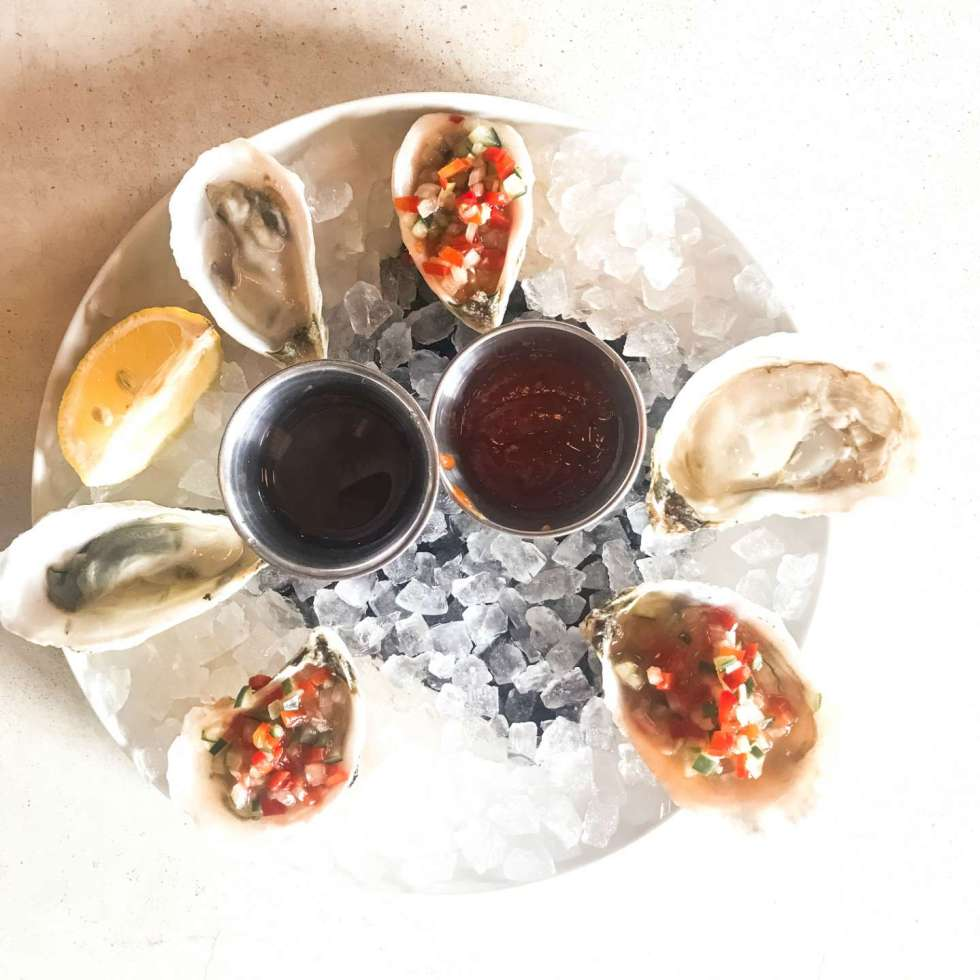 Raleigh Oyster Crawl - I'm Fixin' To - @mbg0112 | Raleigh Oyster Crawl by popular North Carolina blog, I'm Fixin' To: image of oysters on a ice n a white ceramic plate.