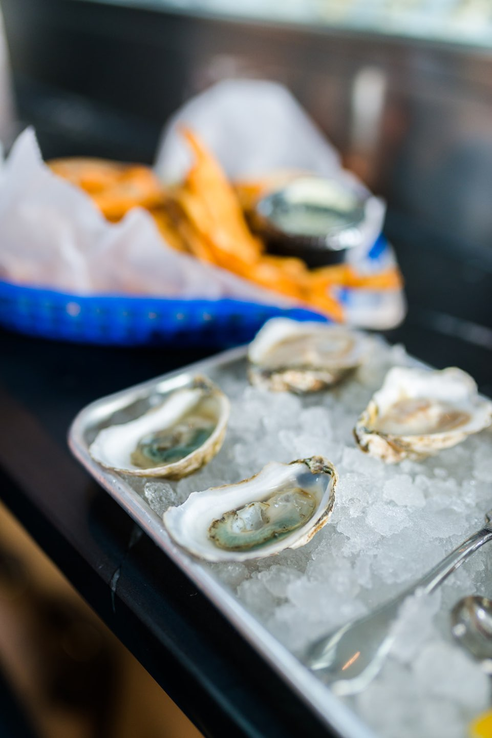 Raleigh Oyster Crawl - I'm Fixin' To - @mbg0112 | Raleigh Oyster Crawl by popular North Carolina blog, I'm Fixin' To: image of oysters on ice in a metal tray.