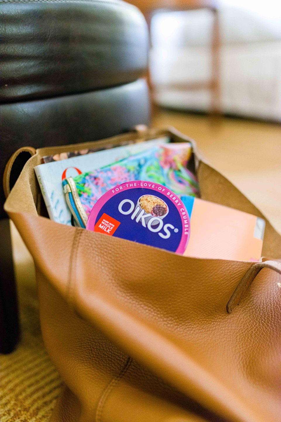 A Quick Dessert Idea that Will Satisfy your Cravings - I'm Fixin' To - @mbg0112 | Oikos, a quick desert idea that will satisfy your sweet cravings, featured by top US lifestyle blog, I'm Fixin To: image of an Oikos yogurt in a woman's handbag