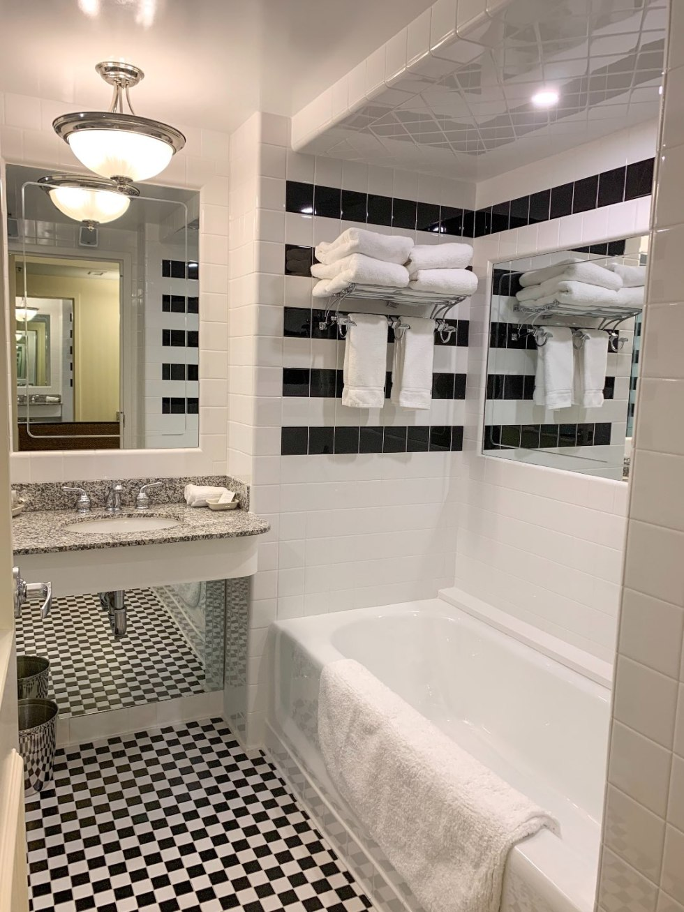A Night at the O.Henry Hotel In Greensboro, NC - I'm Fixin' To - @mbg0112 | A Night at the O.Henry Hotel In Greensboro, NC by popular North Carolina blog, I'm fixin' To: image of a black and white tiled bathroom in a king room in the O. Henry Hotel.