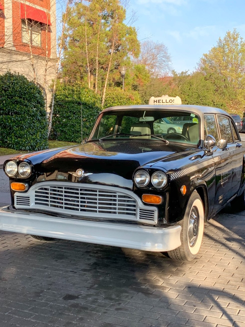 A Night at the O.Henry Hotel In Greensboro, NC - I'm Fixin' To - @mbg0112 |  A Night at the O.Henry Hotel In Greensboro, NC by popular North Carolina blog, I'm fixin' To: image of a vintage taxi cab at the O. Henry Hotel.