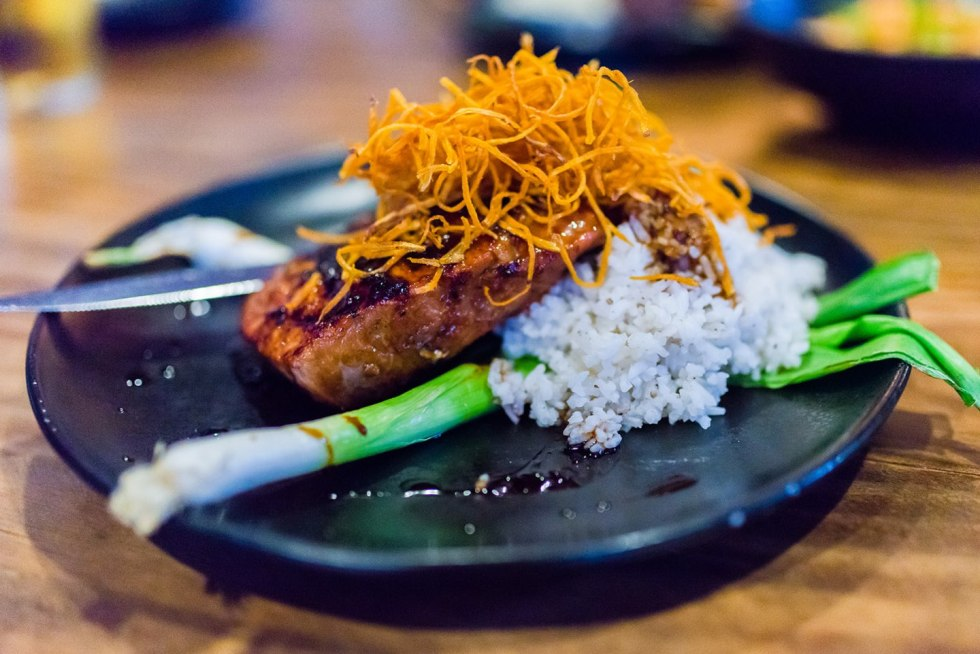 Top 5 Best Destination Restaurants in Eastern NC you Need to Try - I'm Fixin' To - @mbg0112 | Top 5 Best Destination Restaurants in Eastern NC you Need to Try by popular North Carolina blog, I'm Fixin' To: image of plated fish and rice at The Hen and the Hog.