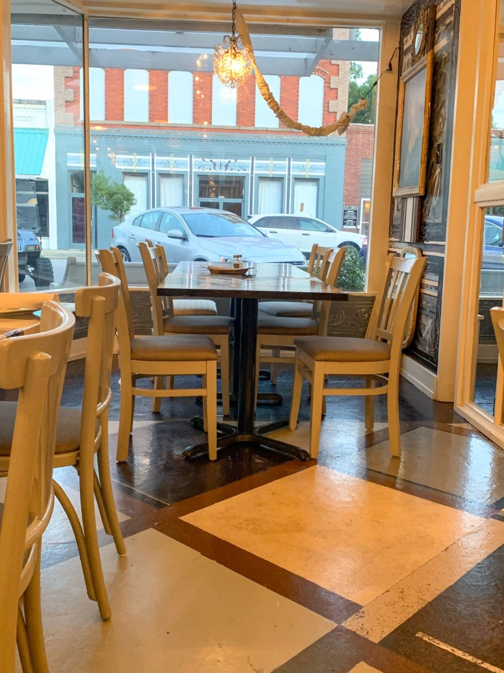 Top 5 Best Destination Restaurants in Eastern NC you Need to Try - I'm Fixin' To - @mbg0112 | Top 5 Best Destination Restaurants in Eastern NC you Need to Try by popular North Carolina blog, I'm Fixin' To: image of table and chairs at Spoon River.