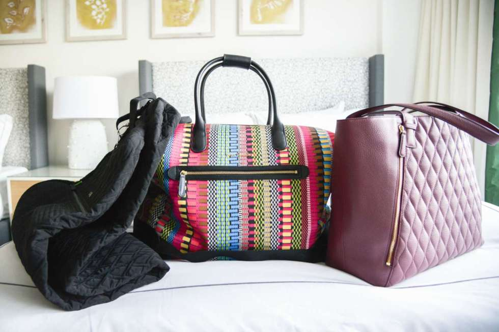 The Ultimate Girls' Weekend Packing List: 15 Essentials You'll Need - I'm Fixin' To - @mbg0112 | The Ultimate Girls' Weekend Packing List: 15 Essentials You'll Need by popular North Carolina travel blog, I'm Fixin' To: image of three travel bags on a hotel bed.