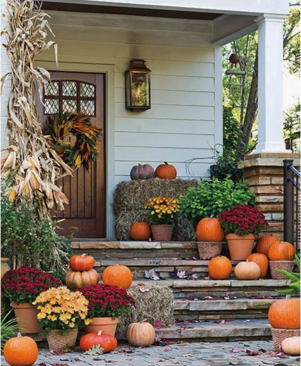 Inspiration Board: Fall Front Porch Ideas - I'm Fixin' To - @mbg0112 | Inspiration Board: Fall Front Porch Ideas by popular North Carolina life and style blog, I'm Fixin' To: image of a front porch decorated with corn stalks, potted mums, hay bales, and pumpkins.