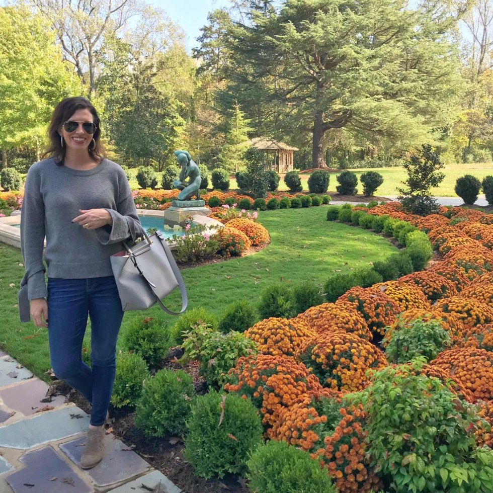 Top 5 Best Fall Vacations in North Carolina by popular North Carolina blog, I'm Fixin' To: image of a woman outside in a garden at the Graylyn Estate in Winston-Salem North Carolina.