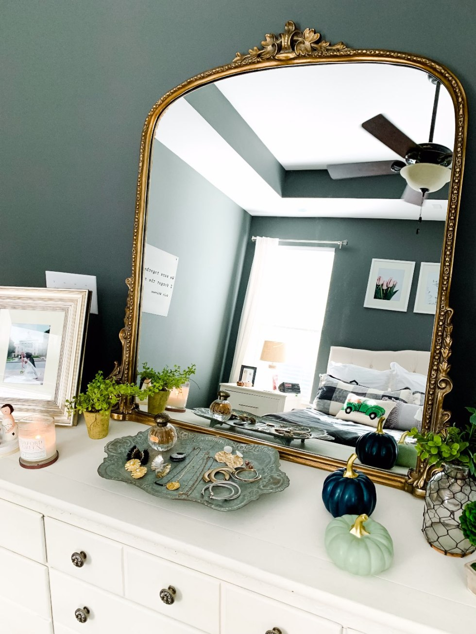 Our Fall Home Decor & Foyer Reveal - I'm Fixin' To - @mbg0112 | Cozy Fall Decor Ideas for your Home & Foyer by popular North Carolina life and style blog, I'm Fixin' To: image of a dresser with a Anthropologie Gleaming Primrose Mirror.