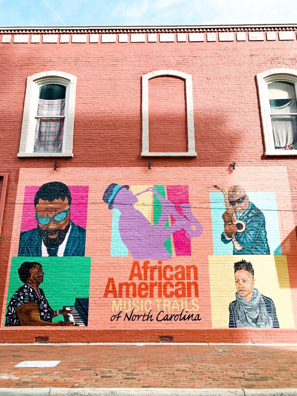 Eastern North Carolina Travel Guide: Top 10 Things to Do in Goldsboro NC by popular North Carolina blog, I'm Fixin' To: image of a African American wall mural.