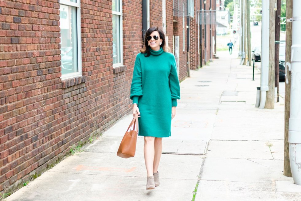 4 Thanksgiving Outfit Ideas by popular North Carolina fashion blog, I'm Fixin' To: image of a woman outside wearing a J. Crew Turtleneck sweater dress in supersoft yarn, Cuyana Small Structured Leather Tote, Mignonne Gavigan Mini Madeline Statement Earrings, Nordstrom Vince Camuto Patellen Bootie and Nordstrom Ray-Ban 'Polarized Original Aviator' 58mm Sunglasses.