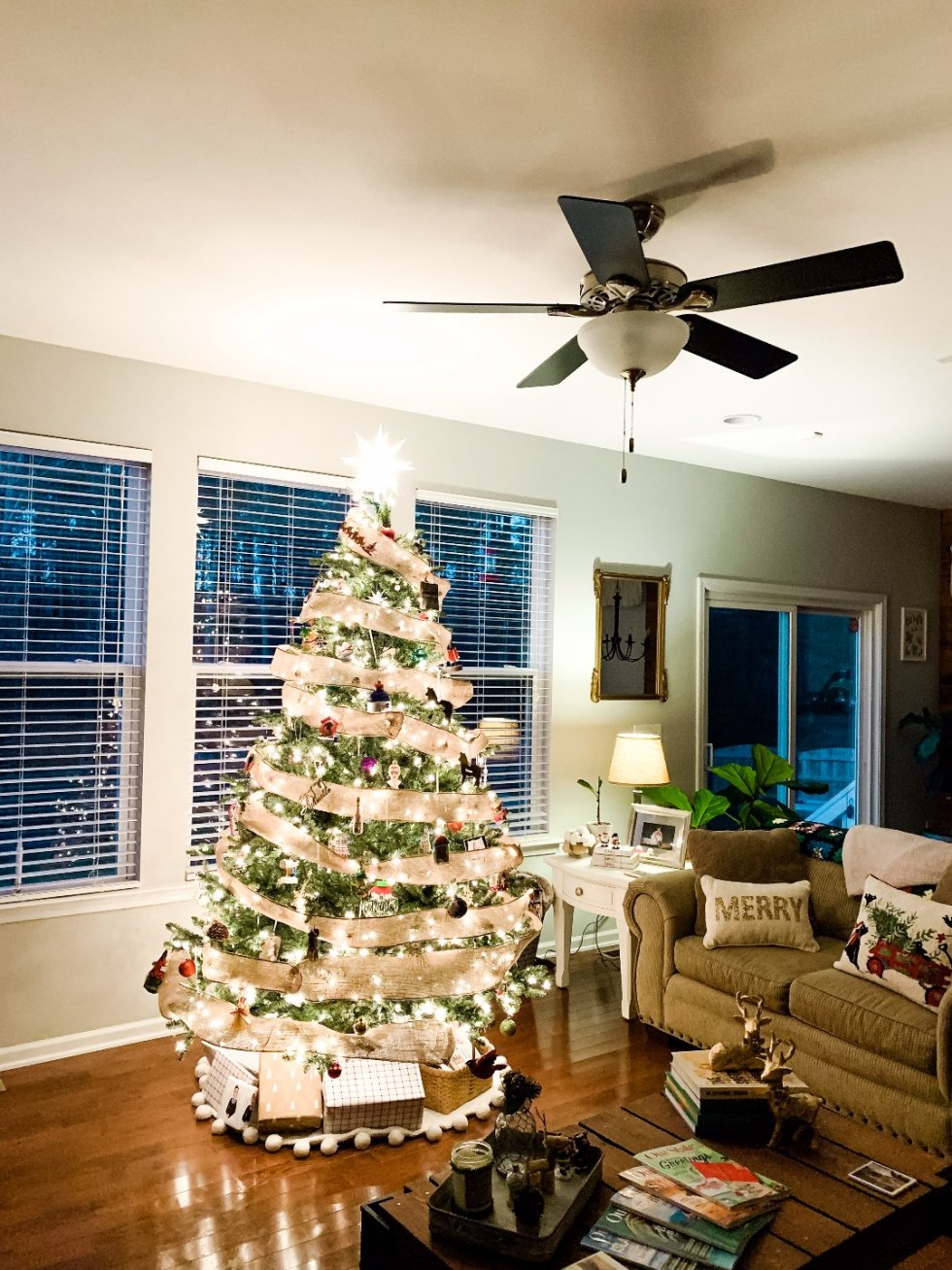 Holiday Home Decor Tour - I'm Fixin' To - @mbg0112 | Holiday Home Decor Tour by popular North Carolina life and style blog, I'm Fixin' To: image of a living room decorated with stockings and a Balsam Hill Christmas Tree.