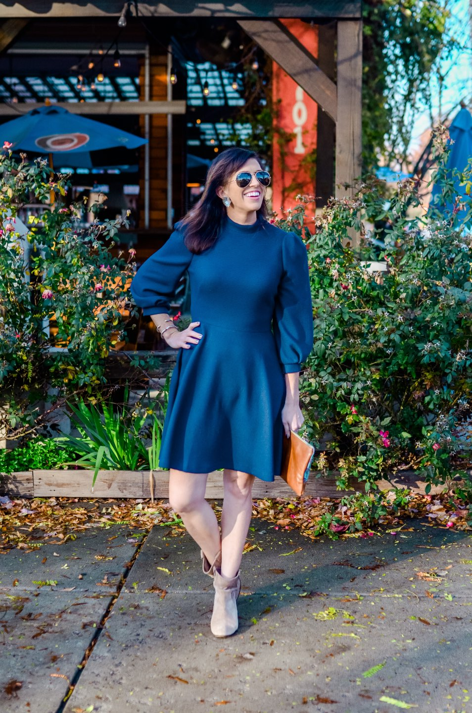 Holiday Style and Outfit Inspiration - I'm Fixin' To - @mbg0112 | Holiday Style and Outfit Inspiration by popular North Carolina fashion blog, I'm Fixin' To: image of a woman outside wearing a Gal Meets Glam Maggie Dress, Nordstrom 'Aviator' Polarized 62mm Sunglasses, Vince Camuto ankle boots, Etsy Up a Tree Cup a Tea Pine Cone Bloom Overshot Textile and Leather Clutch, Nordstrom David Yurman Cable Classic Buckle Bracelet with 18K Gold, Nordstrom David Yurman Cable Classics Bracelet with 14K Gold, Nordstrom Mignonne Gavigan Earrings, and Sephora Bite Beauty lipstick.