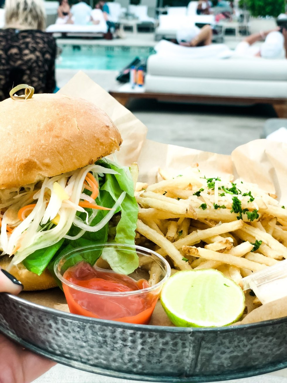 Warming Up in the Bahamas: the Best Things to Do at Baha Mar - I'm Fixin' To - @mbg0112 | Warming Up in the Bahamas: the Best Things to Do in Baha Mar by popular North Carolina travel blog, I'm Fixin' To: image of a burger and some fries.