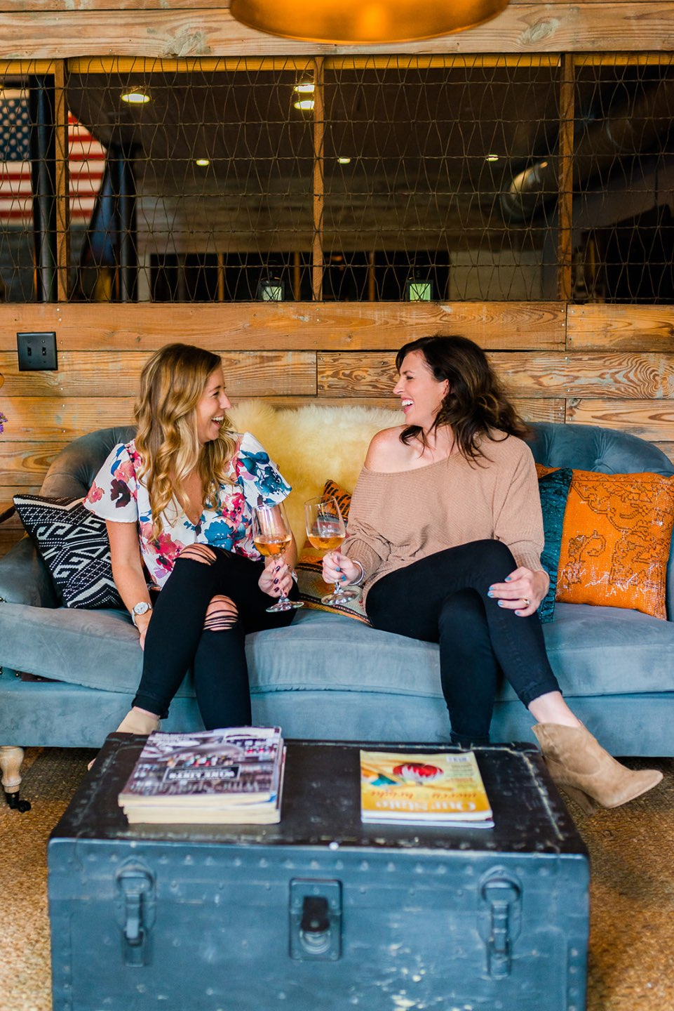 How to Set Healthy Boundaries with Friends: 8 Essential Tips - I'm Fixin' To - @mbg0112 | How to Set Healthy Boundaries with Friends: 8 Essential Tips by popular NC life and style blog, I'm Fixin' To: image of a woman sitting on a couch with a friend while they share a drink.
