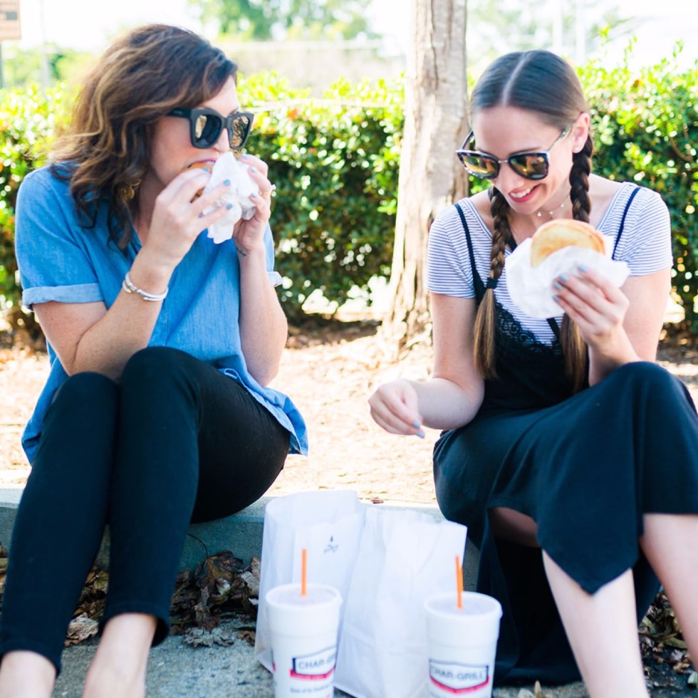 How to Set Healthy Boundaries with Friends: 8 Essential Tips - I'm Fixin' To - @mbg0112 | How to Set Healthy Boundaries with Friends: 8 Essential Tips by popular NC life and style blog, I'm Fixin' To: image of a woman eating burgers with a friend.