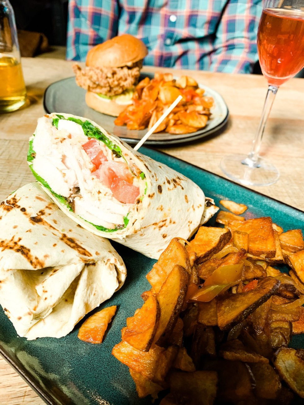 Where to Get Brunch in Raleigh: the 7 Best Spots - I'm Fixin' To - @mbg0112 | Brunch in Raleigh by popular Raleigh blog, I'm Fixin To: image of a Whiskey Kitchen chicken wrap.