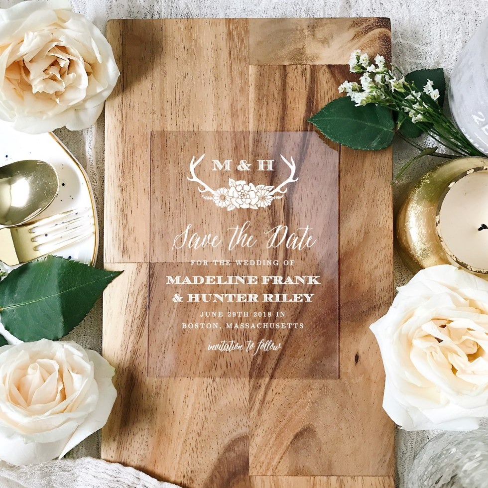 5 Tips for Choosing the Right Save the Date Template - I'm Fixin' To - @mbg0112 | Save the Date Template Options by popular Raleigh lifestyle blog, I'm Fixin To: image of a Basic Invite save the date card on a wooden cutting board surrounded by white roses.