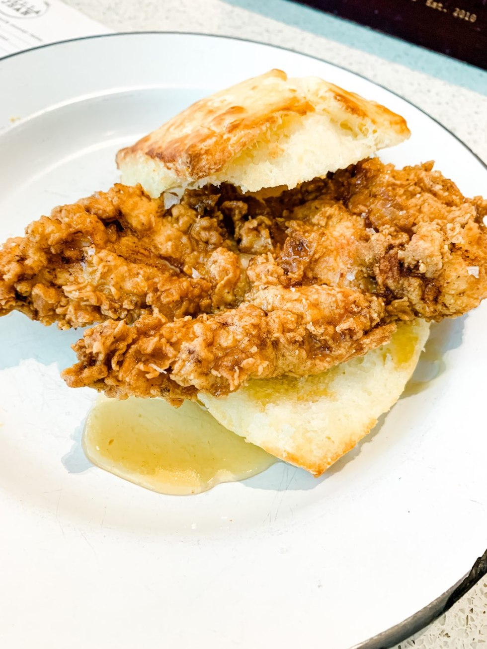 A Girls Trip to New Orleans: All the Info you Need to Prepare! - I'm Fixin' To - @mbg0112 | Girls Trip to New Orleans by popular US travel blog, I'm Fixin To: image of fried chicken and biscuits at Willa Jean.