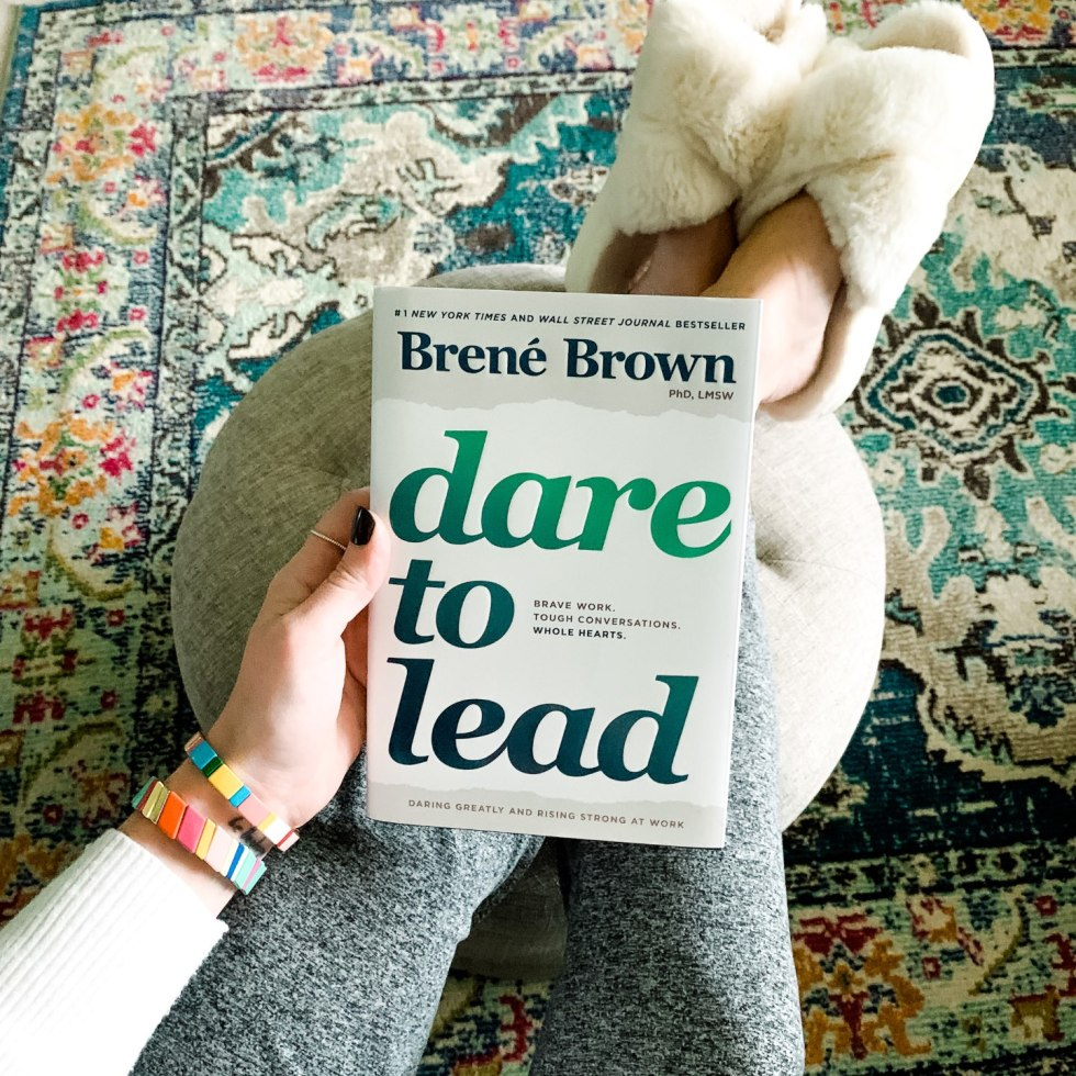 5 Leadership Books for Women that'll Change your Life - I'm Fixin' To - @mbg0112 | Best Leadership Books for Women by popular NC lifestyle blog, I'm Fixin' To: image of a woman holding the Brene Brown 'Dare to Lead' book.