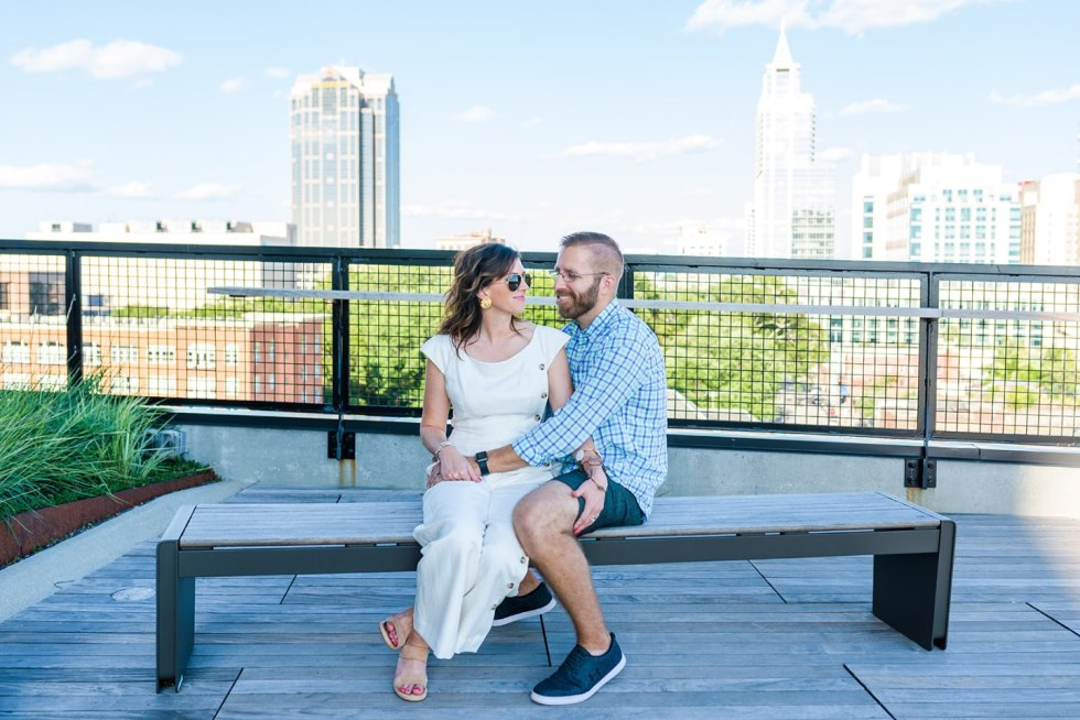 The Perfect Date Night Itinerary in 3 Raleigh Neighborhoods - I'm Fixin' To - @mbg0112 | Raleigh Date Night by popular NC blog, I'm Fixin' To: image of a couple embracing each other while sitting on a bench.