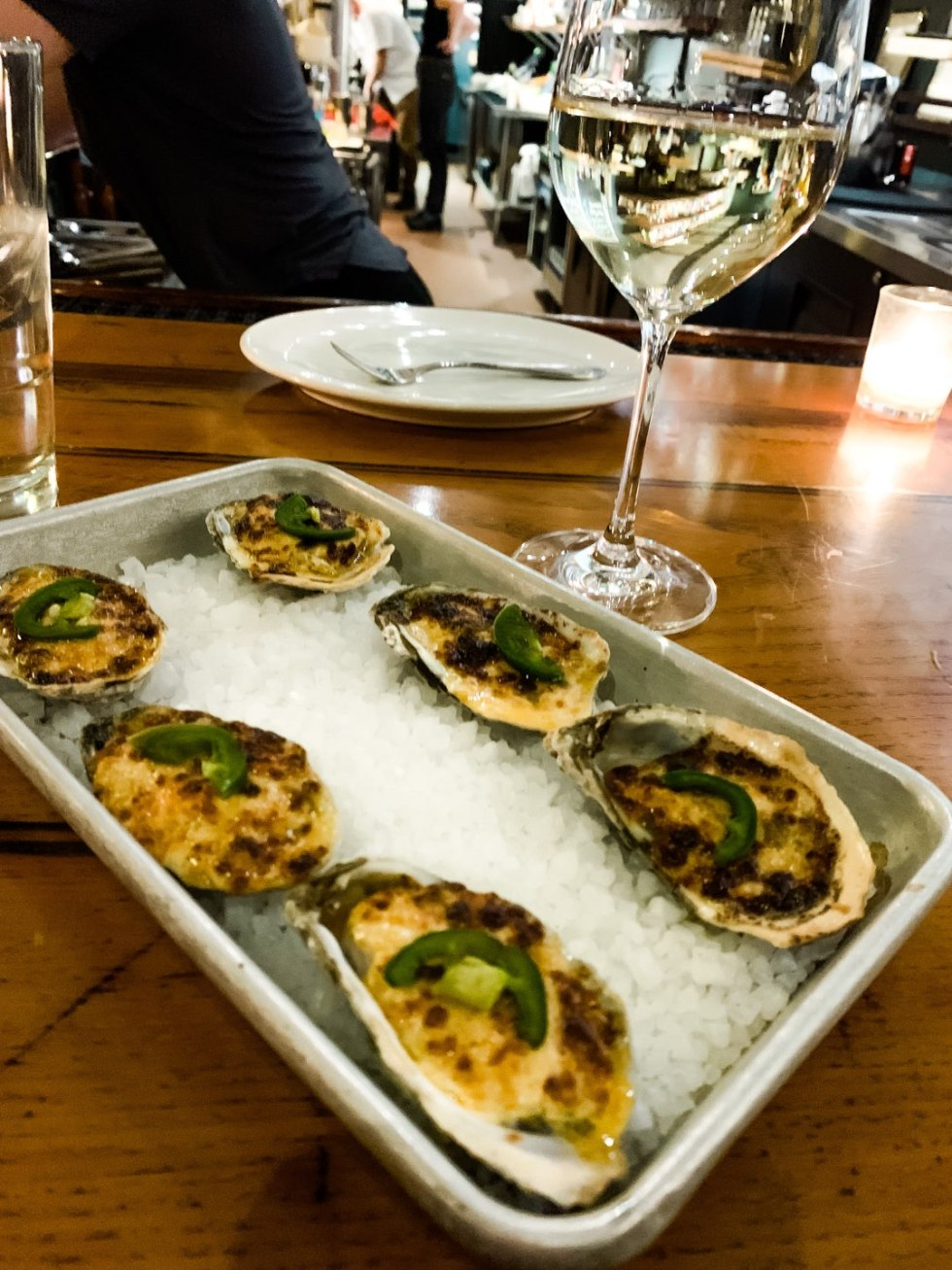 The Perfect Date Night Itinerary in 3 Raleigh Neighborhoods - I'm Fixin' To - @mbg0112 | Raleigh Date Night by popular NC blog, I'm Fixin' To: image of a pan of oyster at Wilmington St.