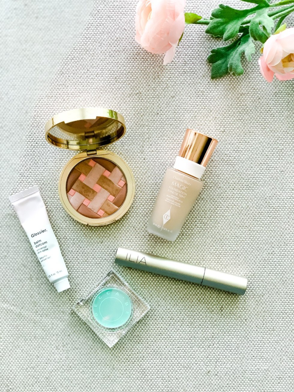 Amazon Beauty Essentials by popular North Carolina beauty blog, I'm Fixin' To: image of a BECCA Anti-Fatigue Under Eye Primer, Charlotte Tilbury Magic Foundation, Too Faced Sweetie Pie Bronzer, ILIA Limitless Lash Mascara, and Glossier balm dot.com.