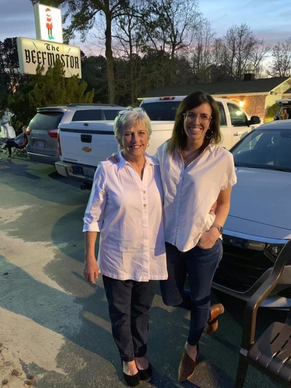 Mother's Day Gift Ideas for the Homebound Mom - I'm Fixin' To - @mbg0112 | Thoughtful Mother's Day Gift Ideas by popular N.C. lifestyle blog, I'm Fixin' To: image of a mom and daughter standing outside The Beefmastor restaurant.