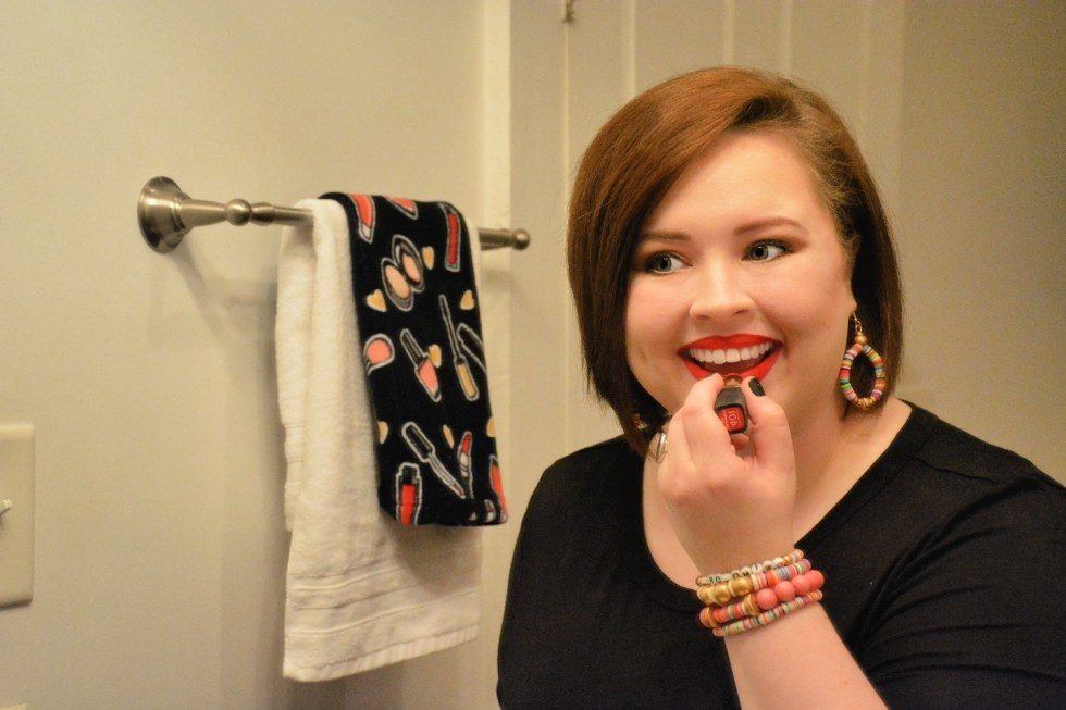 The Empowered Women Series: How to Rock a Red Lip with Hannah Dawson - I'm Fixin' To - @mbg0112 | Hannah Hardy by popular NC beauty blog, I'm Fixin' To: image of Hannah Hardy applying red lipstick.