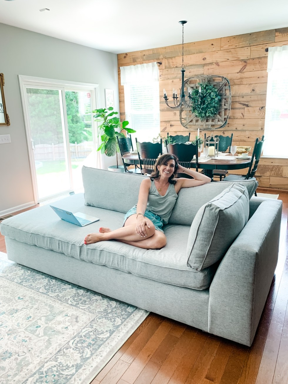 Inspiration Board: Living Room - I'm Fixin' To - @mbg0112 | Living Room Inspiration by popular N.C. life and style blog, I'm Fixin' To: image of a woman sitting next to her laptop on a West Elm Harris 2-Piece Terminal Chaise Sectional.