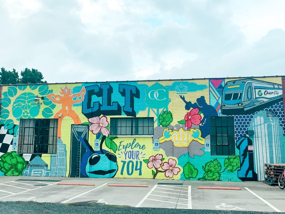 Weekend in Charlotte: Best Breweries and Places to Eat - I'm Fixin' To - @mbg0112 | Weekend in Charlotte by popular N.C. travel blog, I'm Fixin' To: image of a colorful wall mural.