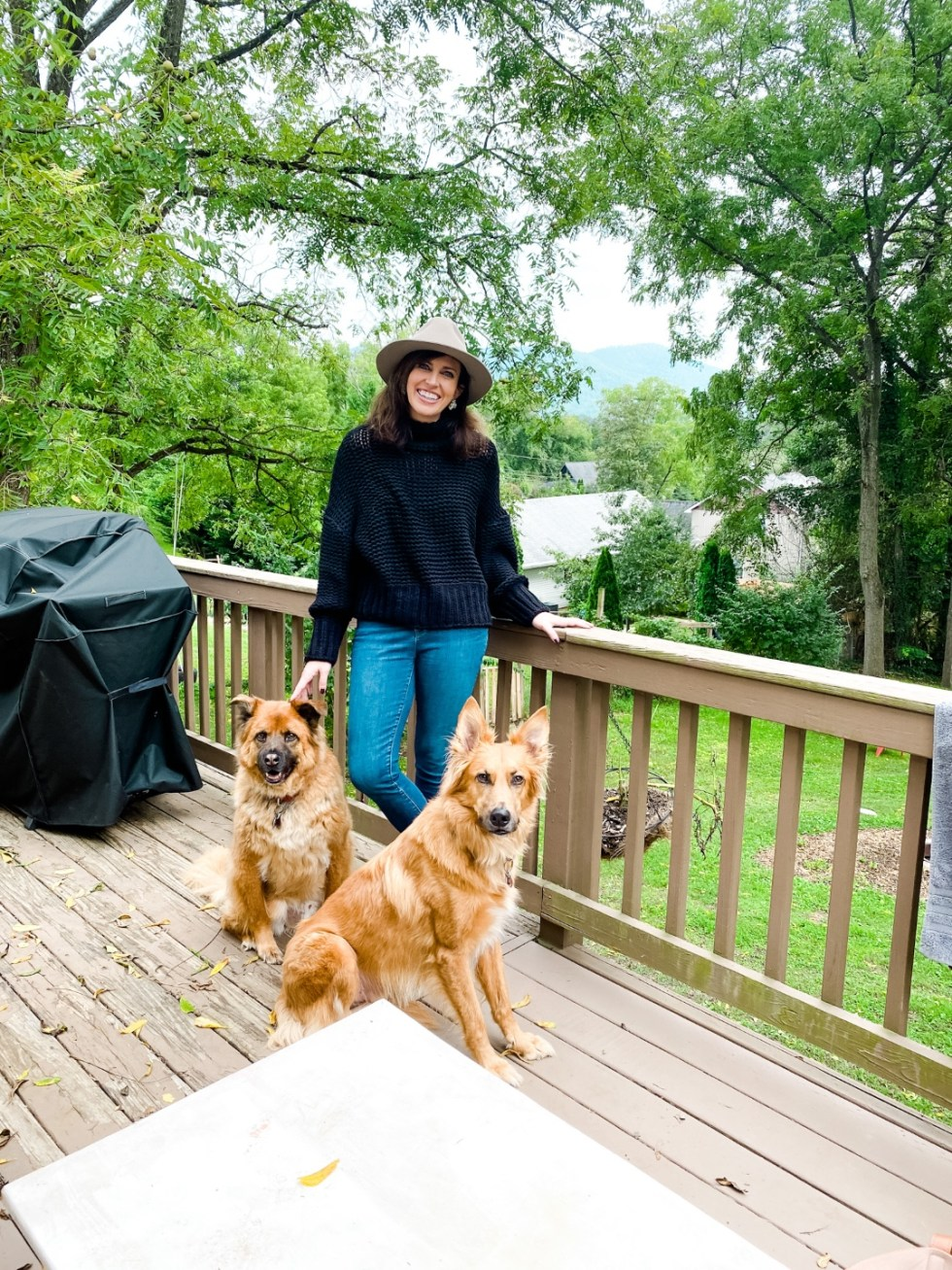 A Casual Weekend in Asheville: the Best Things to Do with your Dogs - I'm Fixin' To - @mbg0112   Weekend In Asheville by popular NC travel blog, I'm Fixin' To: image of a woman standing on a deck with her two dogs.