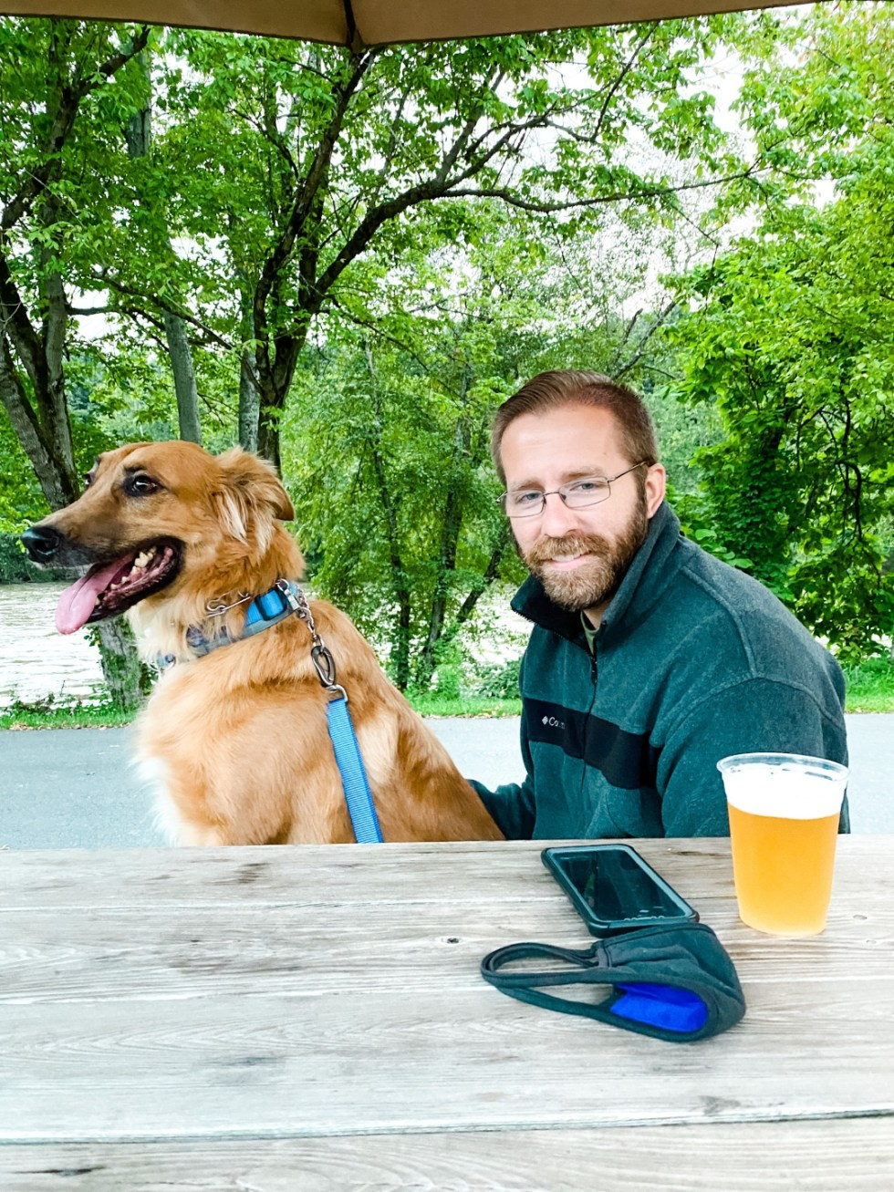 A Casual Weekend in Asheville: the Best Things to Do with your Dogs - I'm Fixin' To - @mbg0112   Weekend In Asheville by popular NC travel blog, I'm Fixin' To: image of a man sitting outside with his dog.