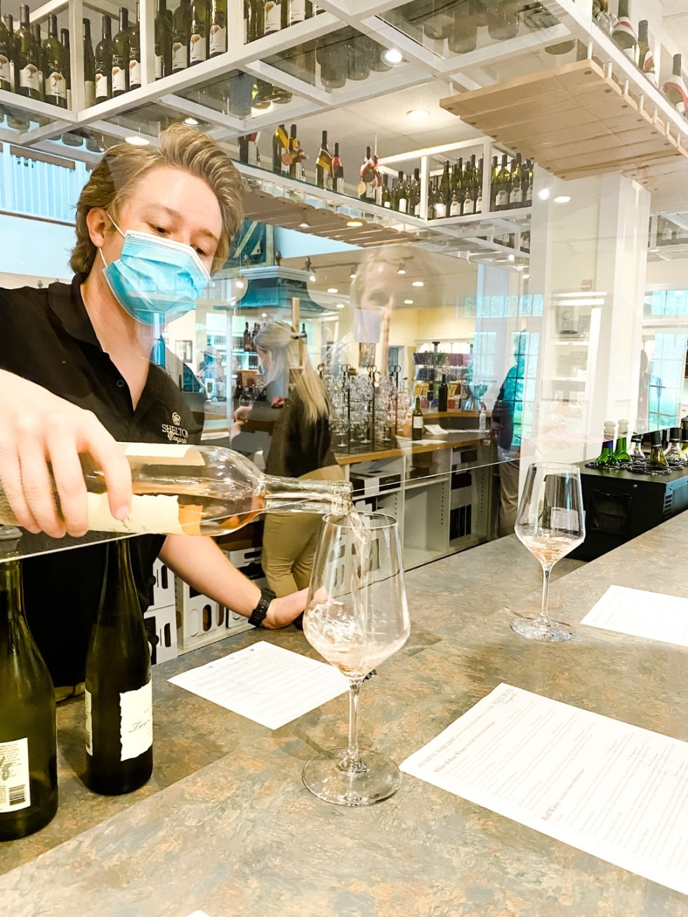 Western NC Wineries: 6 Wineries to Visit During your Next Girls' Weekend - I'm Fixin' To - @mbg0112 |Western NC Wineries by popular NC blog, I'm Fixin' To: image of a man pouring white wine at Shelton Vineyards.