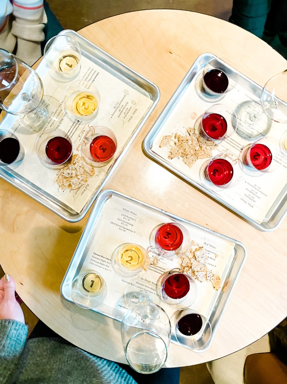 Western NC Wineries: 6 Wineries to Visit During your Next Girls' Weekend - I'm Fixin' To - @mbg0112 |Western NC Wineries by popular NC blog, I'm Fixin' To: image of a wine tasting tray at Grassy Creek Vineyard and Winery.