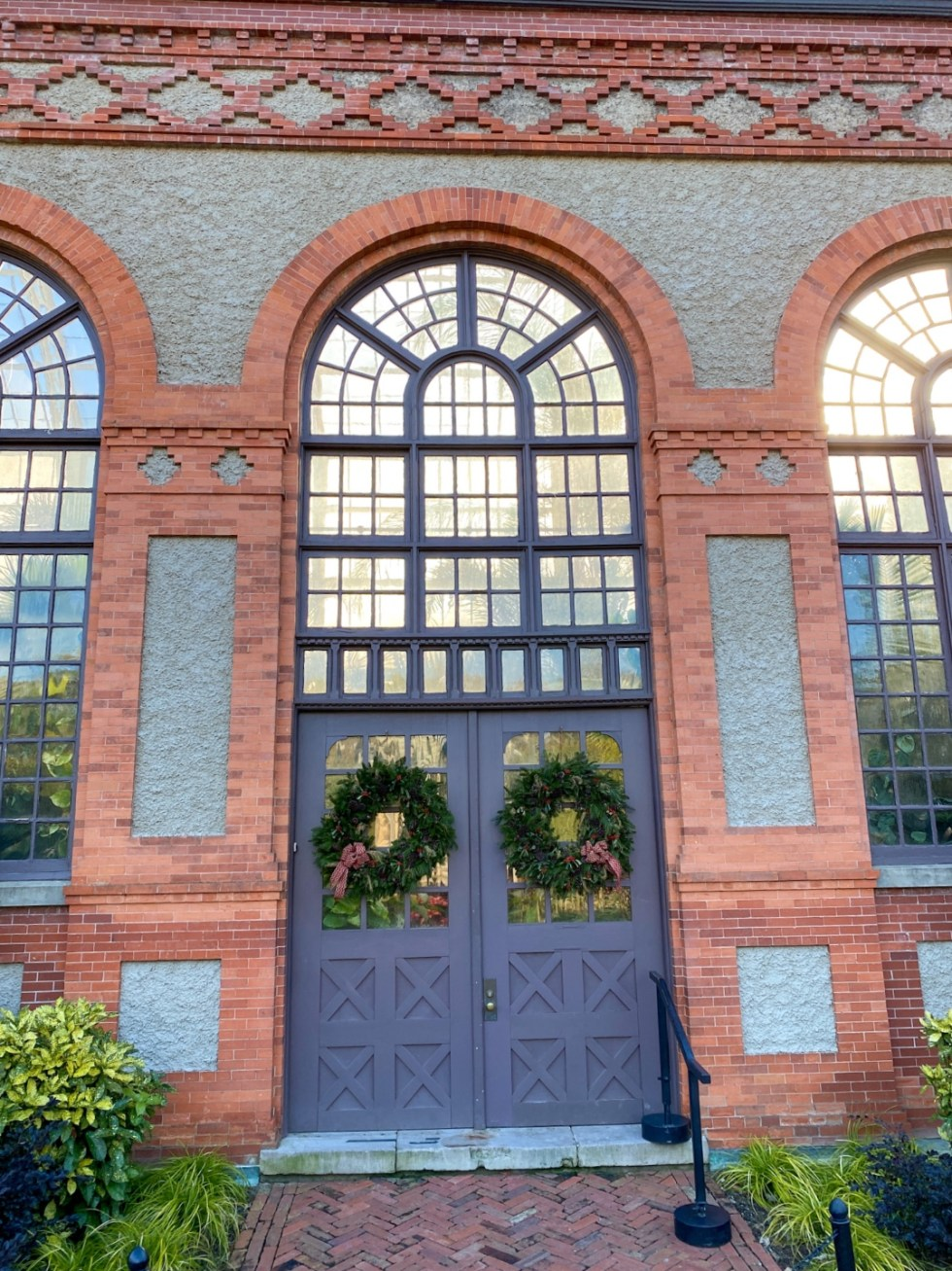 Christmas in Asheville: a Weekend Getaway During the Holidays - I'm Fixin' To - @imfixintoblog |Christmas in Asheville NC by popular NC lifestyle blog, I'm Fixin' To: image of a red brick building with double purple doors.