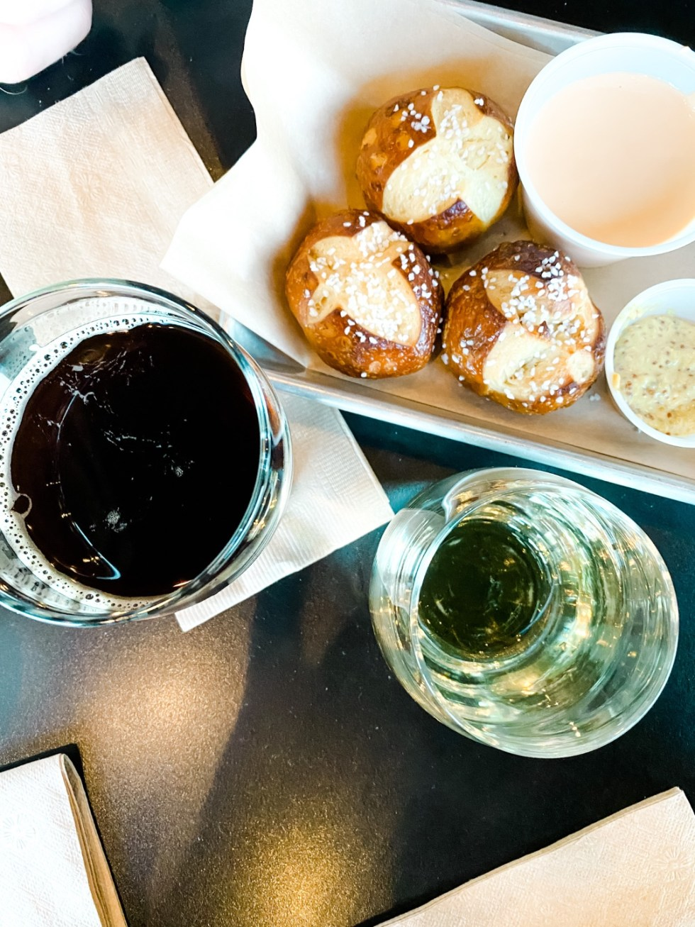 Christmas in Asheville: a Weekend Getaway During the Holidays - I'm Fixin' To - @imfixintoblog |Christmas in Asheville NC by popular NC lifestyle blog, I'm Fixin' To: image of beer and pretzel bites at Hillman Beer.