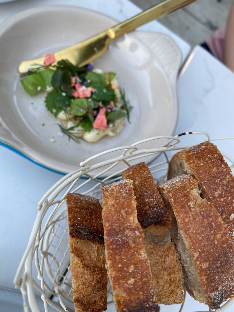 NC Favorites: 5 Warm Restaurants with Patios in the Triangle - I'm Fixin' To - @mbg0112 |Restaurants with Patios in the Triangle by popular NC lifestyle blog, I'm Fixin' To: image of bread in a white wire basket.