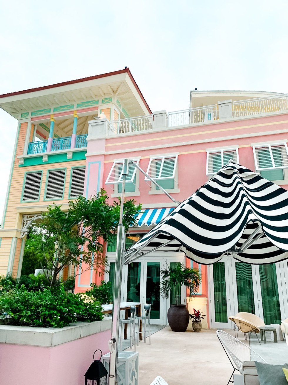 Year in Review by popular NC travel blog, I'm Fixin' To: image of a pink, yellow, green, and blue building in Nassau.