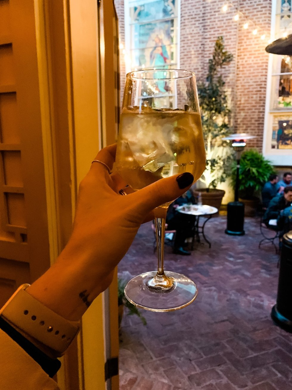 20 Moments I am Grateful for in 2020 - I'm Fixin' To - @imfixintoblog |Moments to be Grateful for by popular NC lifestyle blog, I'm Fixin' To: image of a woman holding a glass of white wine.
