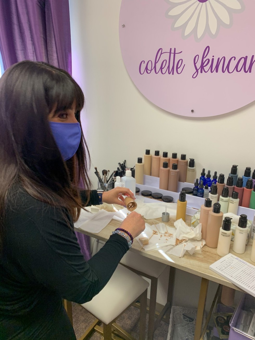 A Custom Foundation Blend at Colette Skincare - I'm Fixin' To - @imfixintoblog |Custom Foundation Blend by popular NC beauty blog, I'm Fixin' To: image of a woman wearing an all black outfit and purple face mask and mixing a custom foundation.