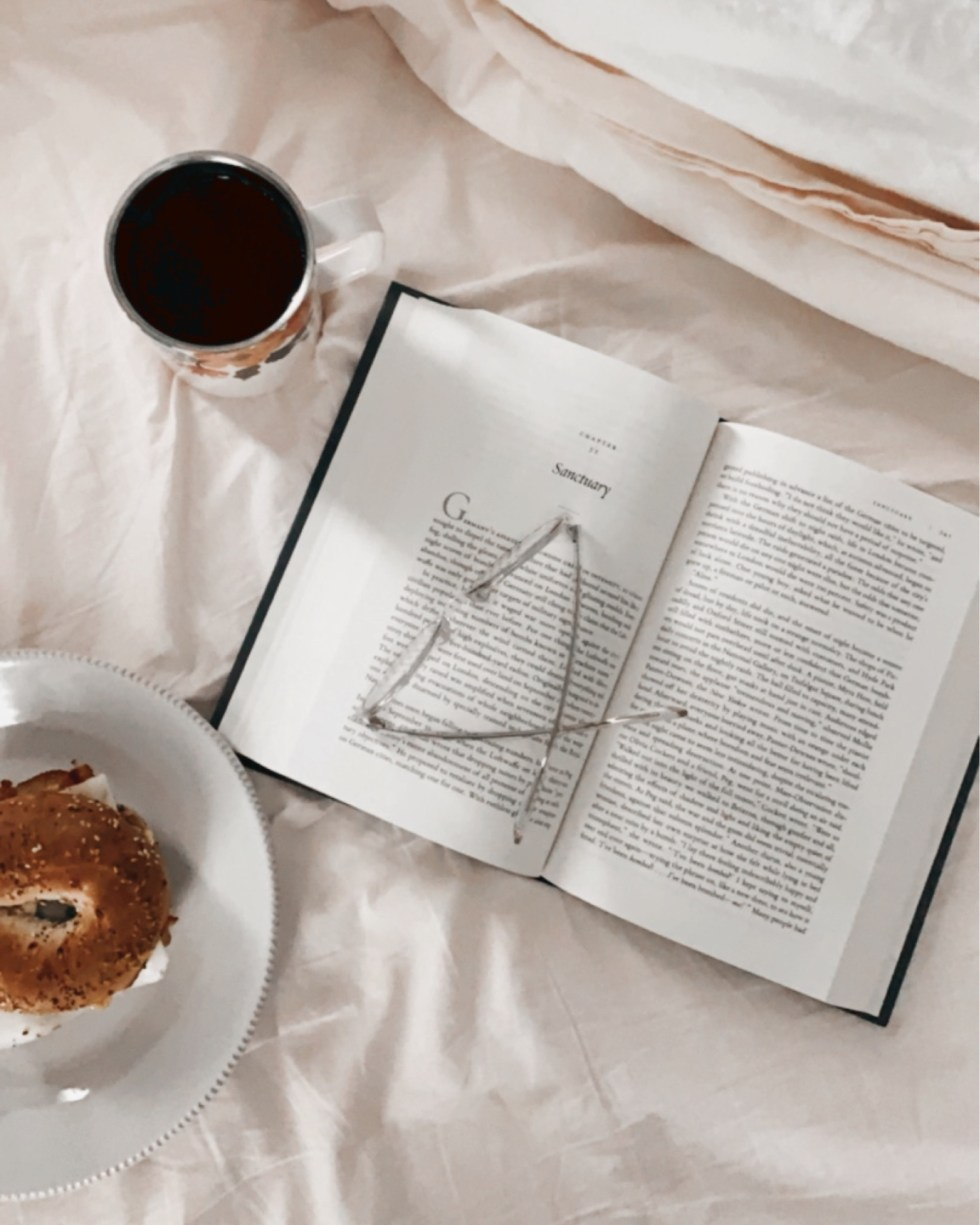 Warby Parker Eye Glasses by popular NC fashion blog, I'm Fixin' To: image of a open book with a pair of Warby Parker eye glasses resting on top.