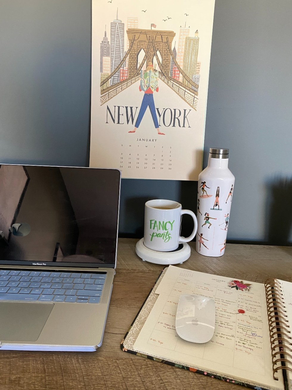How to Make your Home Cozy: 10 Easy Ways - I'm Fixin' To - @imfixintoblog |How to Make Your Home Cozy by popular NC life and style blog, I'm Fixin' To: image of a open Mac laptop next to a ceramic mug on a mug warmer and a open day planner.
