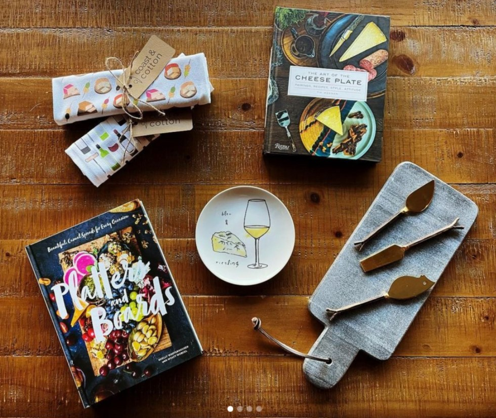 Valentine's Day Gift Guide by popular NC lifestyle blog, I'm Fixin' To: image of coast and cotton towels, The Art of the Cheese Plate book, wine and cheese plate, stone cheese board with gold cheese knives, and a Platters and Boards book.