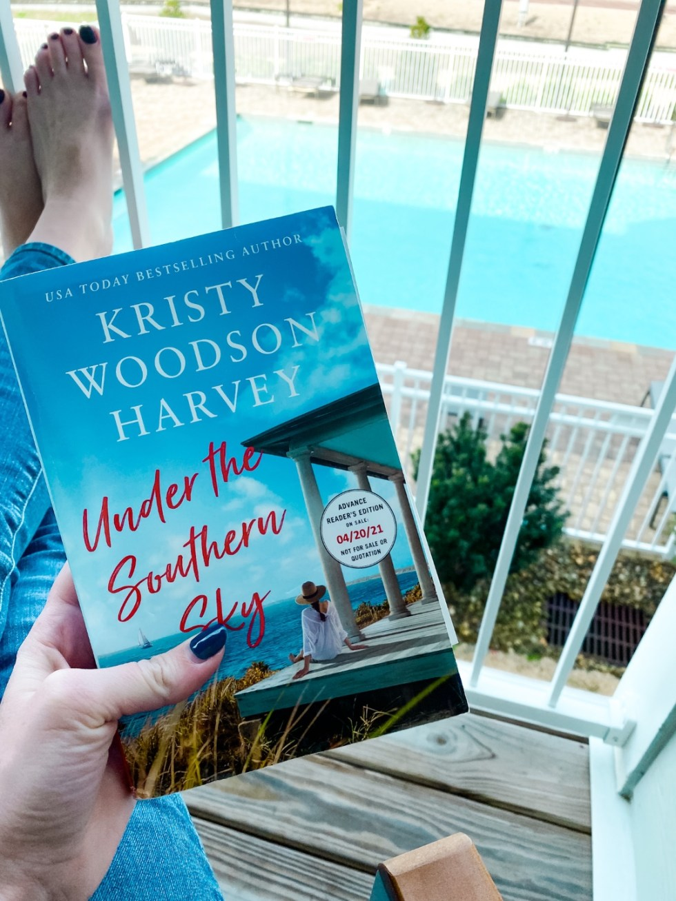 Weekend Travel: The Best Things to Do in Beaufort NC in 48 Hours - I'm Fixin' To - @imfixintoblog |Things to Do in Beaufort NC by popular NC travel blog, I'm Fixin' To: image of a woman holding the book Under the Southern Sky.