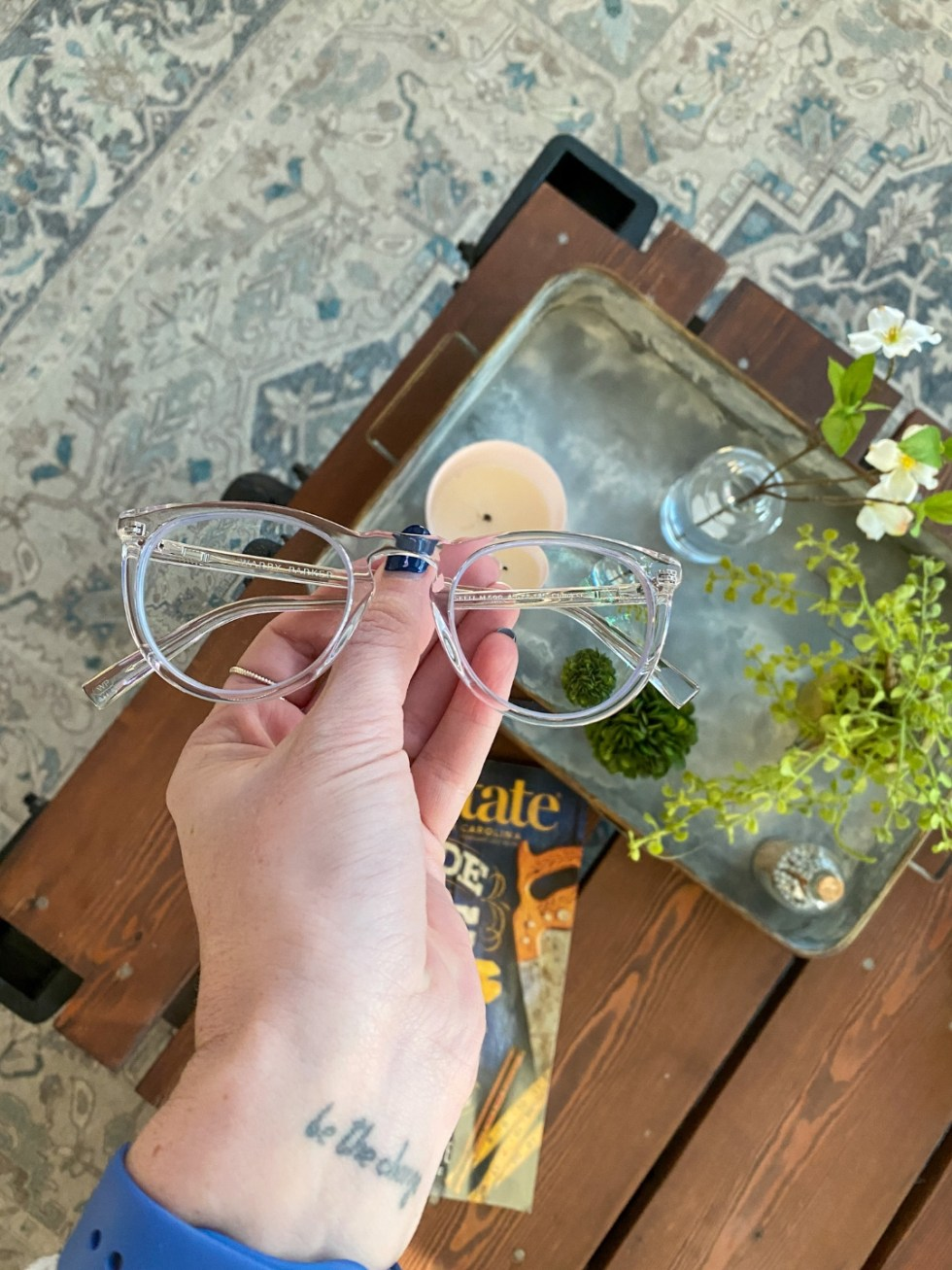 See With Style: Warby Parker Eye Glasses - I'm Fixin' To - @imfixintoblog |Warby Parker Eye Glasses by popular NC fashion blog, I'm Fixin' To: image of a woman holding a pair of Warby Parker glasses.
