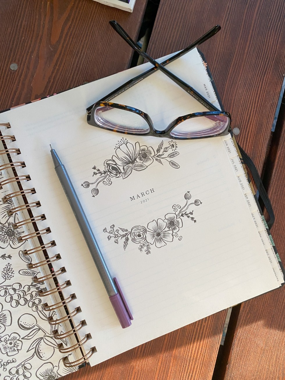 See With Style: Warby Parker Eye Glasses - I'm Fixin' To - @imfixintoblog |Warby Parker Eye Glasses by popular NC fashion blog, I'm Fixin' To: image of a pair of Warby Parker glasses resting on a opened notebook.