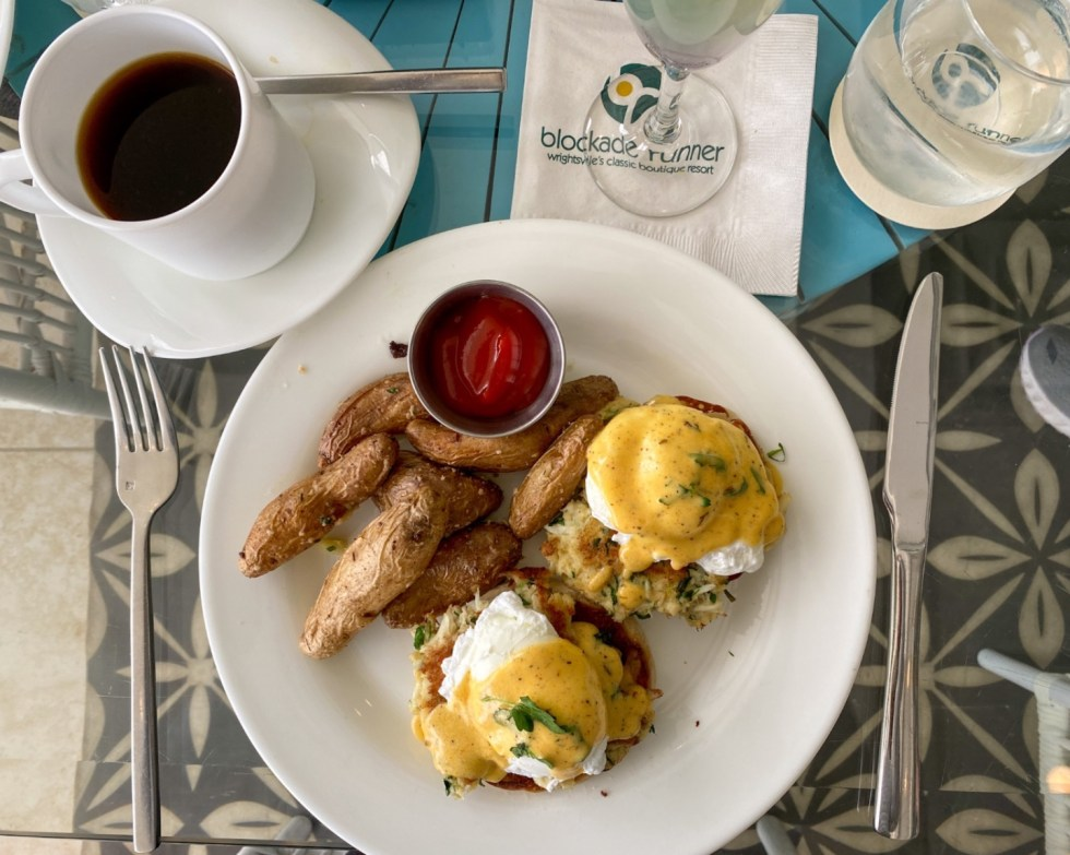 A Spring Weekend in Wilmington, NC: the Best Things to Do - I'm Fixin' To - @imfixintoblog |Weekend in Wilmington by popular NC travel blog, I'm Fixin' To: image of eggs benedict next to a cup of coffee.