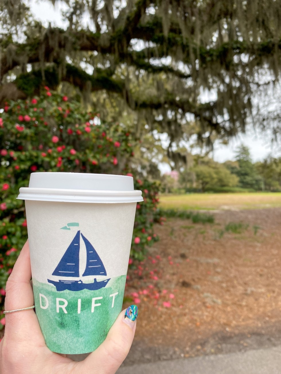 A Spring Weekend in Wilmington, NC: the Best Things to Do - I'm Fixin' To - @imfixintoblog |Weekend in Wilmington by popular NC travel blog, I'm Fixin' To: image of a woman holding a Drift coffee cup.