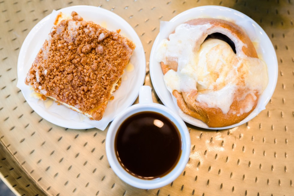 Places to Stay: The Colonial Inn in Hillsborough NC - I'm Fixin' To - @imfixintoblog |The Colonial Inn Hillsborough NC by popular NC travel blog, I'm Fixin' To: image of two pastries next to a cup of coffee.